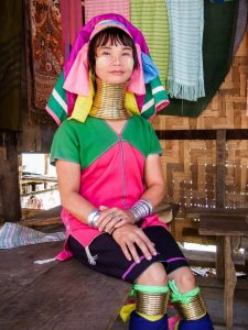 Kayan woman. Neck rings