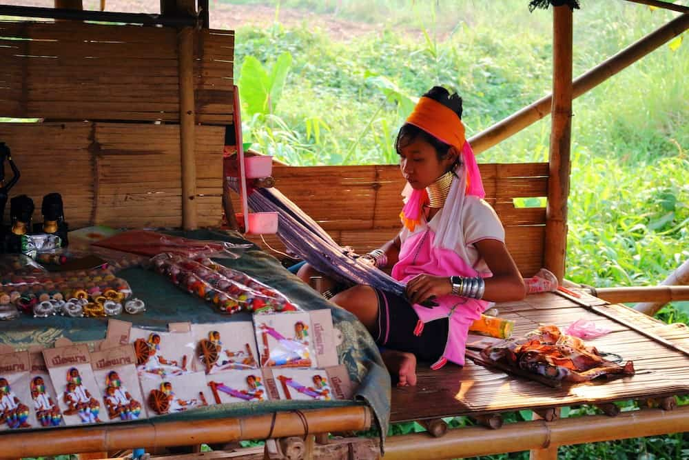 Kayan girl working