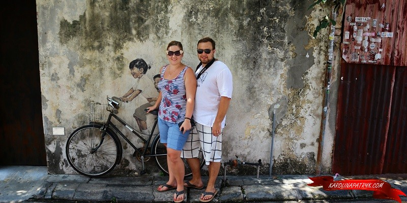 Karolina and Patryk with street art in George Town