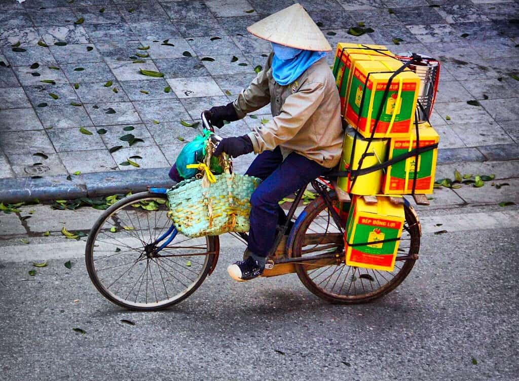 Vietnamese woman on a bike