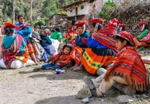 Quechua family in a village in the mountains of The Andes over Ollantaytambo, Peru