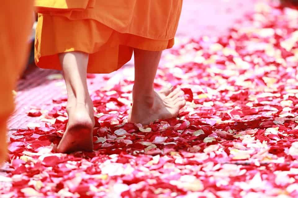 monk walking in Thailand